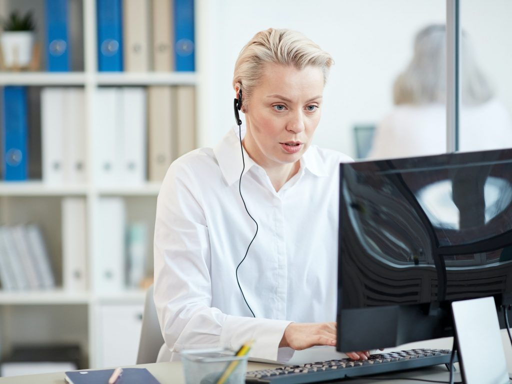 Modern Businesswoman Wearing Headset at Workplace